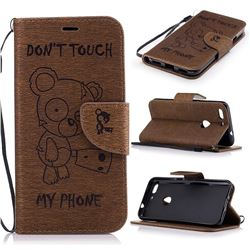 Intricate Embossing Chainsaw Bear Leather Wallet Case for Google Pixel XL - Coffee