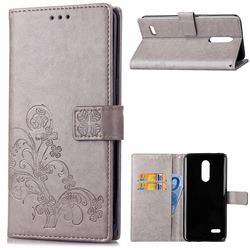 Embossing Imprint Four-Leaf Clover Leather Wallet Case for LG K8 (2018) / LG K9 - Grey