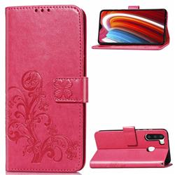 Embossing Imprint Four-Leaf Clover Leather Wallet Case for Samsung Galaxy A21 - Rose