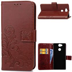 Embossing Imprint Four-Leaf Clover Leather Wallet Case for Sony Xperia L2 - Brown