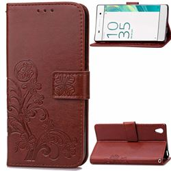 Embossing Imprint Four-Leaf Clover Leather Wallet Case for Sony Xperia X / Sony X Dual - Brown