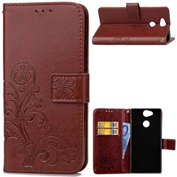 Embossing Imprint Four-Leaf Clover Leather Wallet Case for Sony Xperia XA2 Ultra(6.0 inch) - Brown